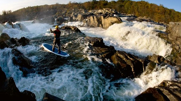 White water stand up paddleboarding