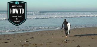 Launching a SUP in waves