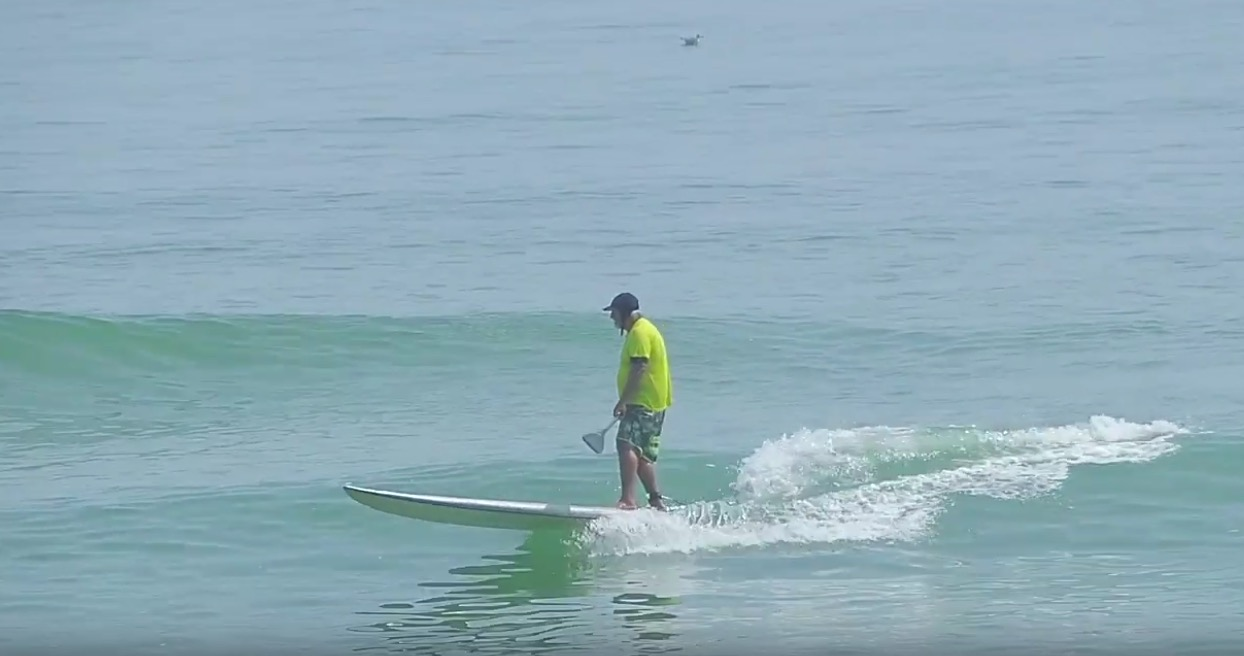SUP surfing a big board